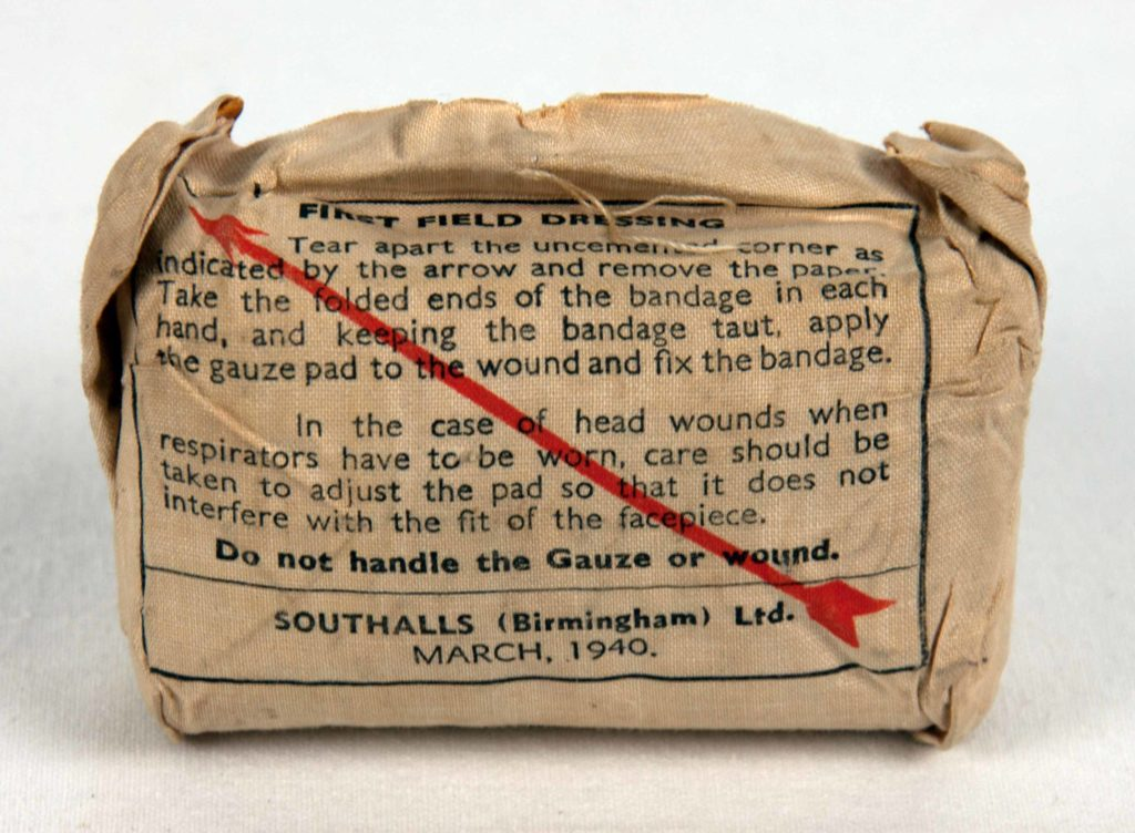 Gauze field dressing made by Southalls (Birmingham) Ltd, 1940. Southalls were using this highly absorbent material to produce sanitary pads in 1880.