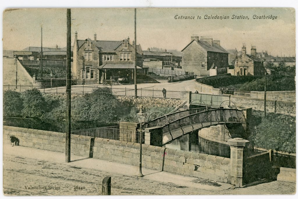 A postcard view across the Monkland Canal, taken from the bridge that carried the North British Railway over the canal. The railway yard on the site of the Coatbridge Hole is off camera just to the photographer's left. Partly obscured by the footbridge you can see the entrance to the Gartsherrie Branch of the canal.