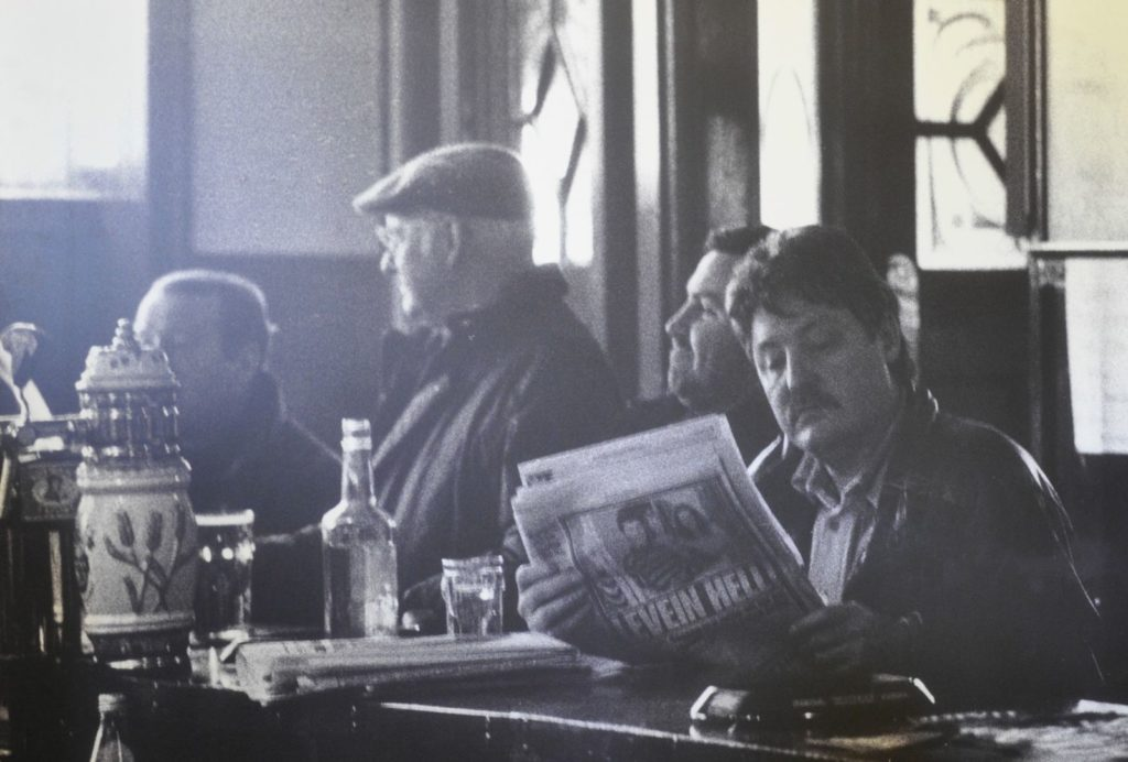 Black and white image of three men sitting in the Horseshoe Bar, Motherwell c.1995