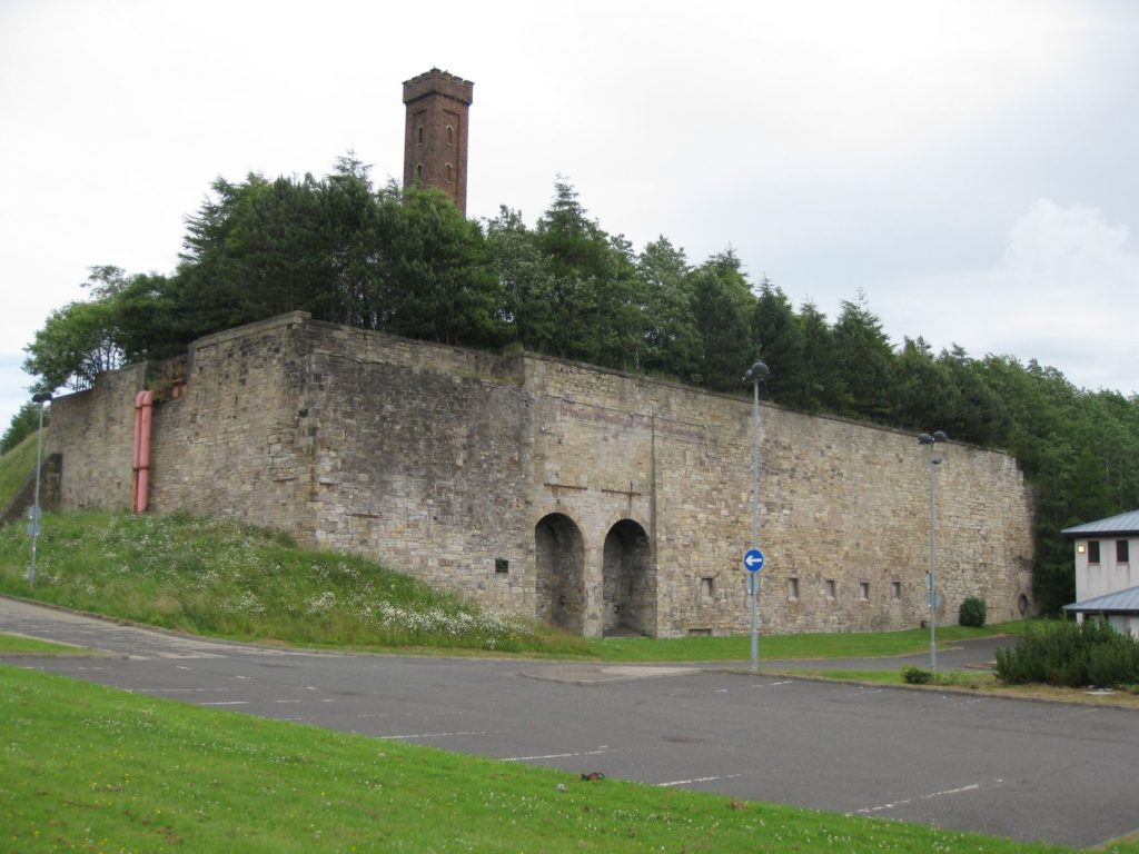 The surviving furnace bank at Shotts and, above it the unique water tower that provided a head of water to cool the 'tuyeres', the nozzles that blew hot air into the blast furnaces.