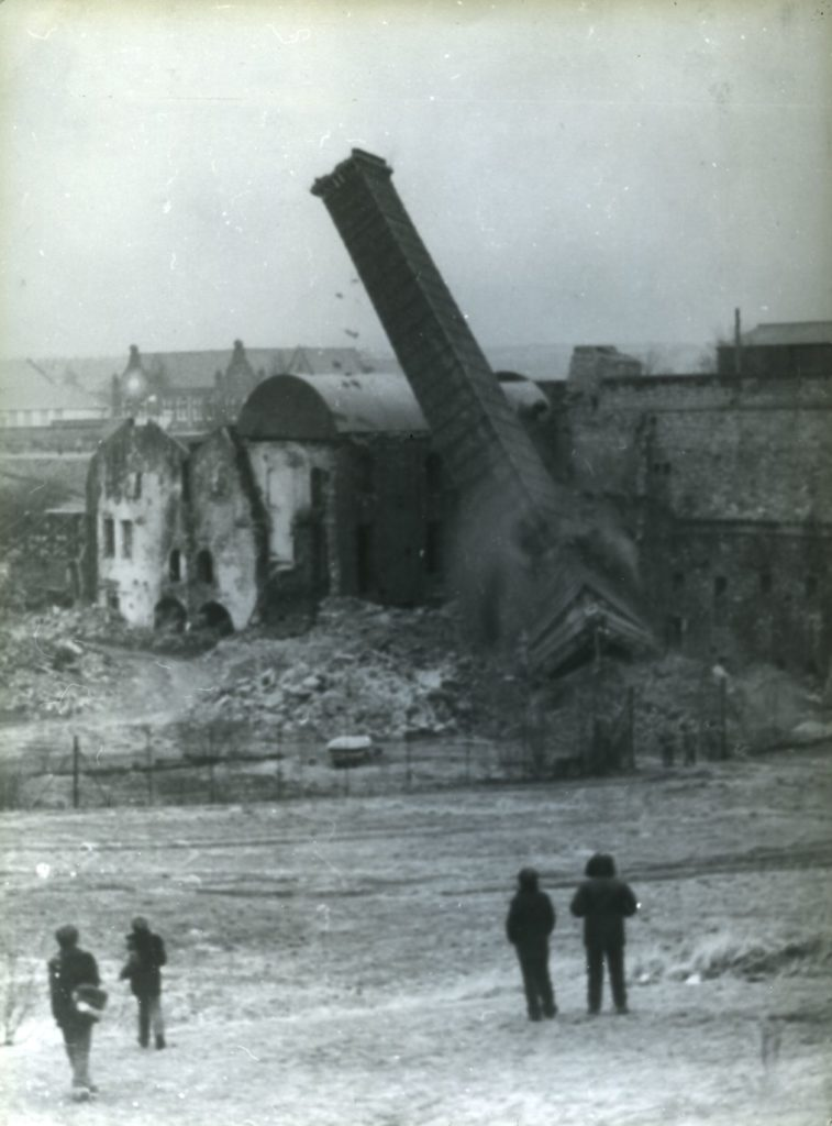The remaining boiler house chimney is felled during the 1980s demolition of the Shotts Iron Works, when most of the remaining structures were cleared. Until that time Shotts had been considered the most important remaining monument to the Scottish pig iron industry.