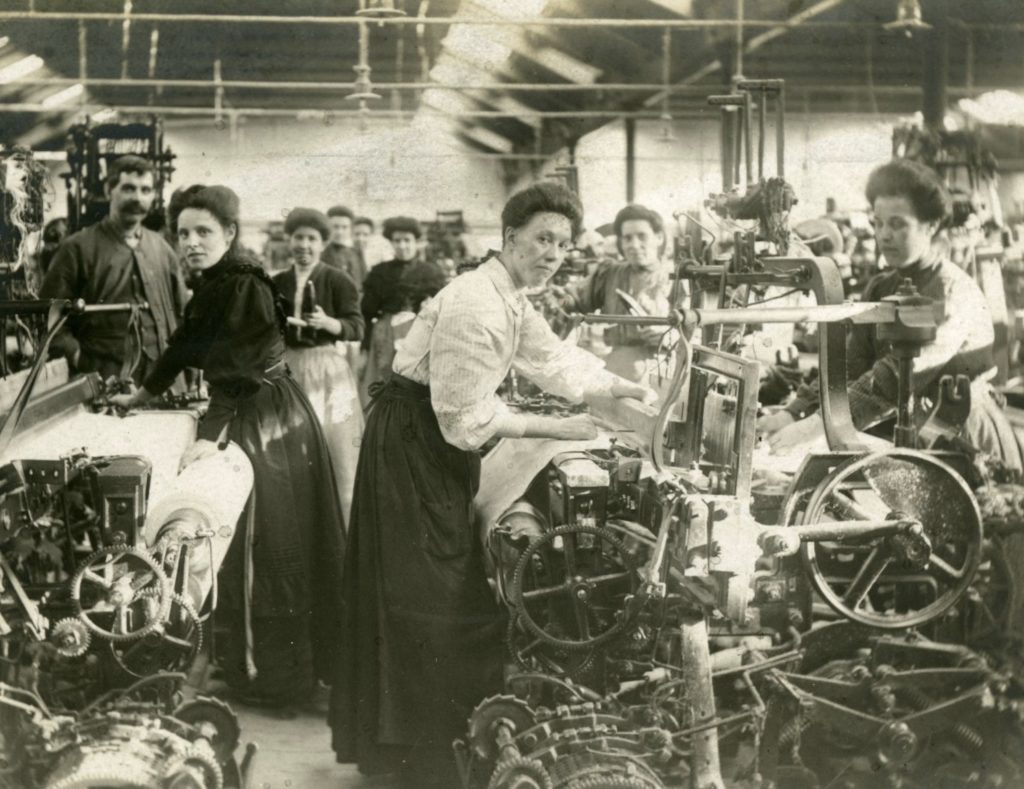 Workers at their power-looms in the Airdrie Cotton Works, around 1910.