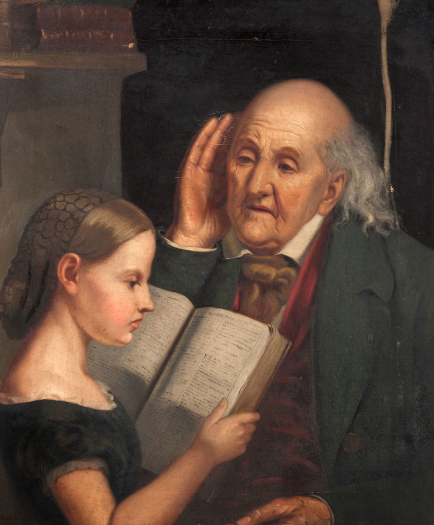 Reading Aloud by John Levack (1828-1874), 1861 depicts a young girl reading a book to an elderly man who is cupping his ear.
