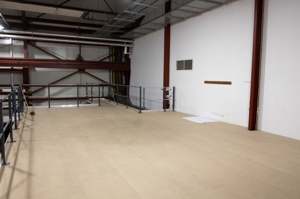 The completed mezzanine before the shelving went in.