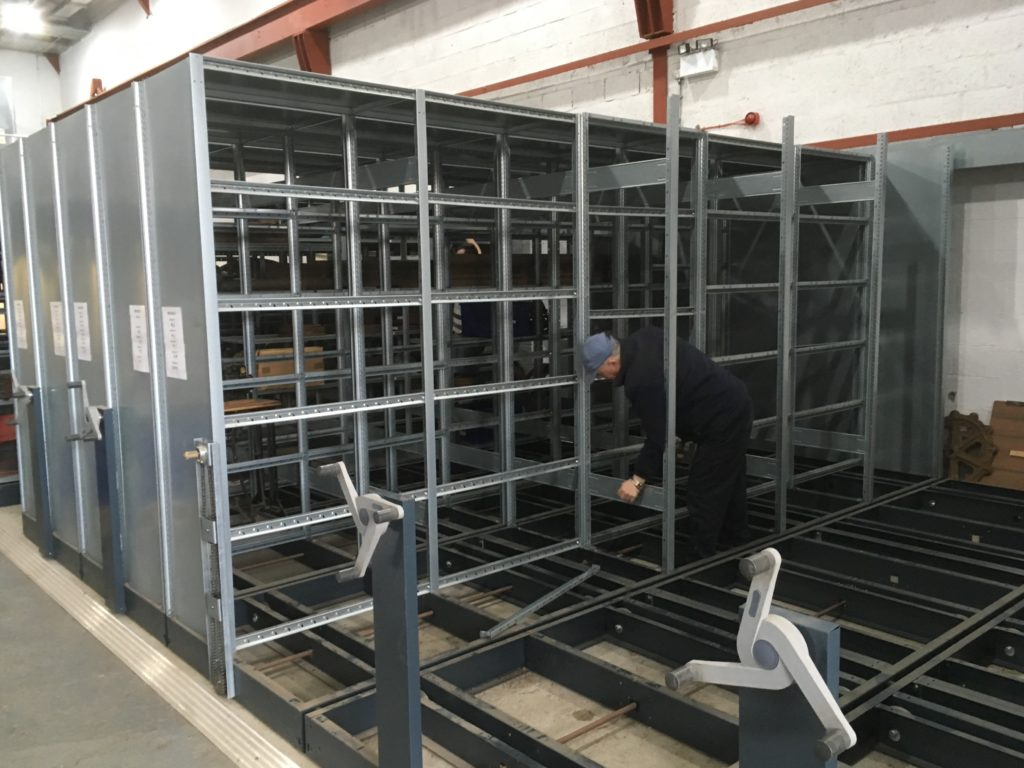Dismantling the mobile shelving ready to move it to underneath the new mezzanine.