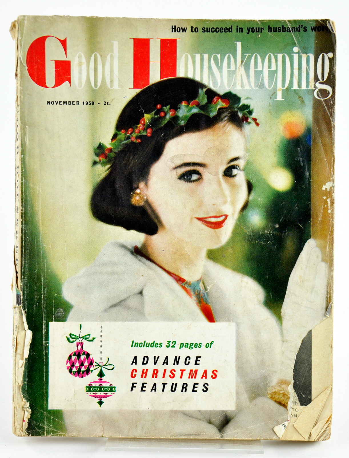 Good Housekeeping magazine, November 1959, depicting a woman wearing a holly wreath and white coat to tie in with 32 pages of advance Christmas features