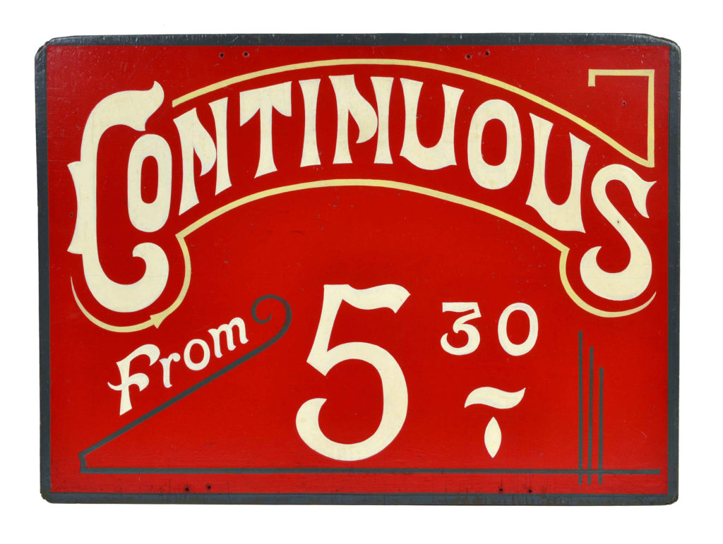 Vintage cinema sign bearing the words 'Continuous from 5.30' in white lettering against a red background
