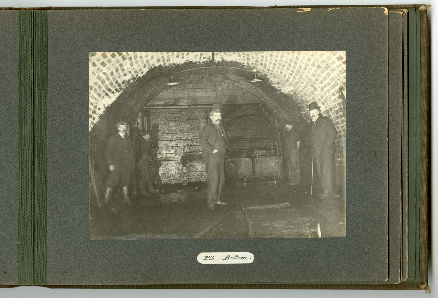 The pit bottom at Camp Colliery near Motherwell around 1910. Two electric lights are visible hanging from the roof.