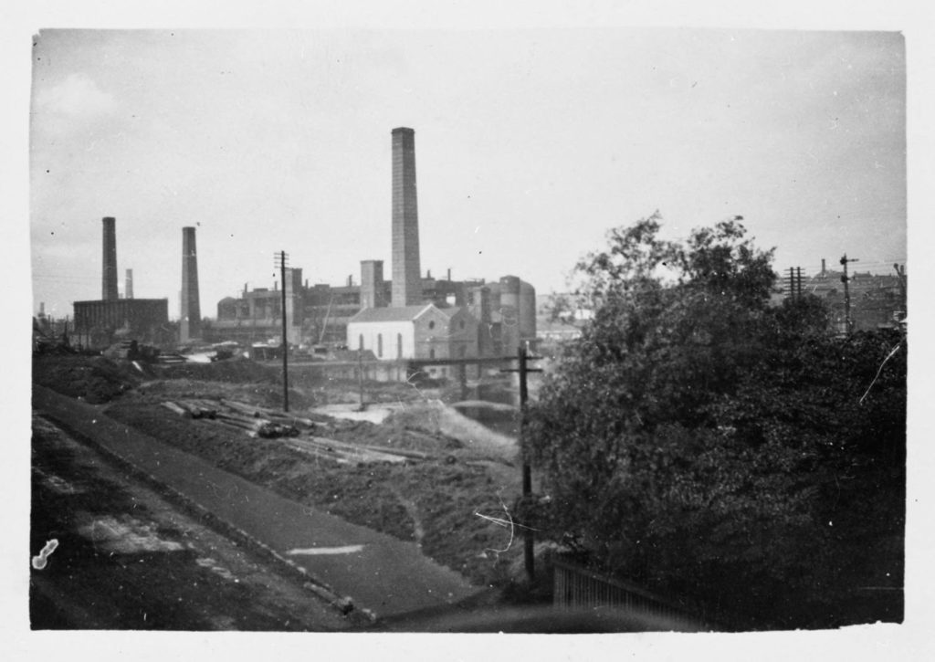 A view of Summerlee Iron Works from the railway cottages opposite Summerlee Gatehouse on what is now Heritage Way. Unknown date before 1938.