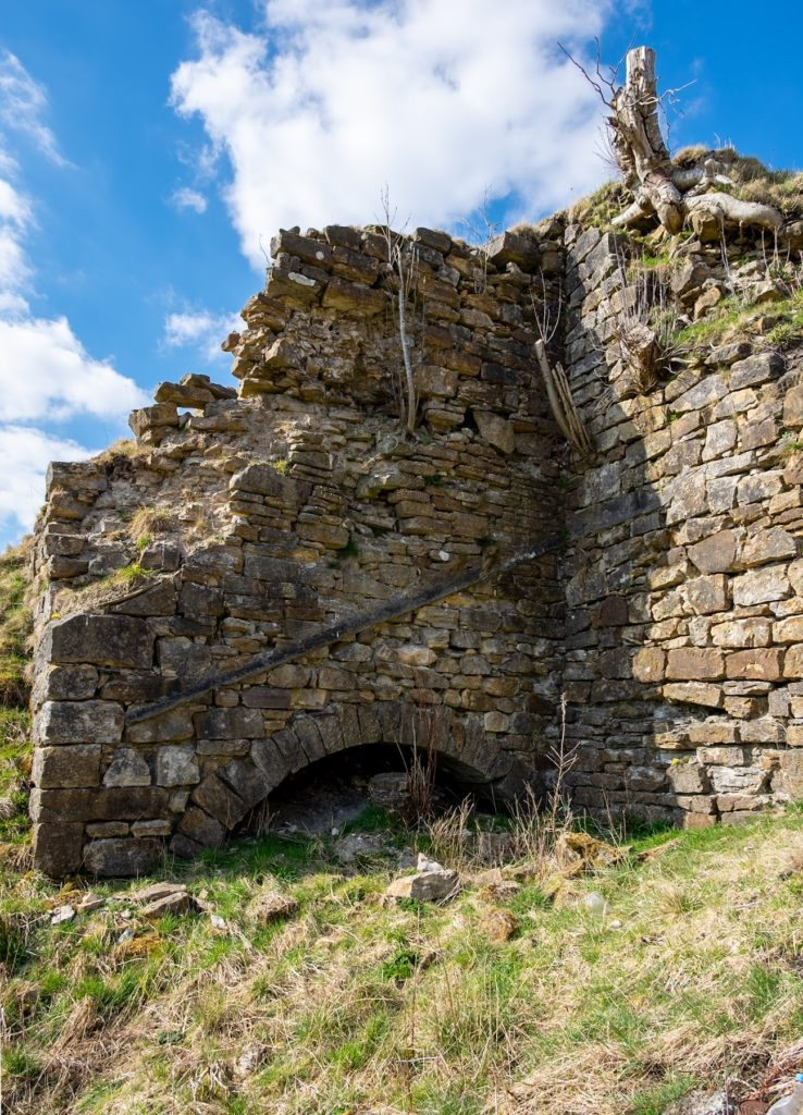 A half-buried blast furnace at the site of the short-lived Glenbuck Iron Works (1795-1813) in Ayrshire. The works was briefly taken over by William Dixon in the early 1800s but had been sold by 1810.