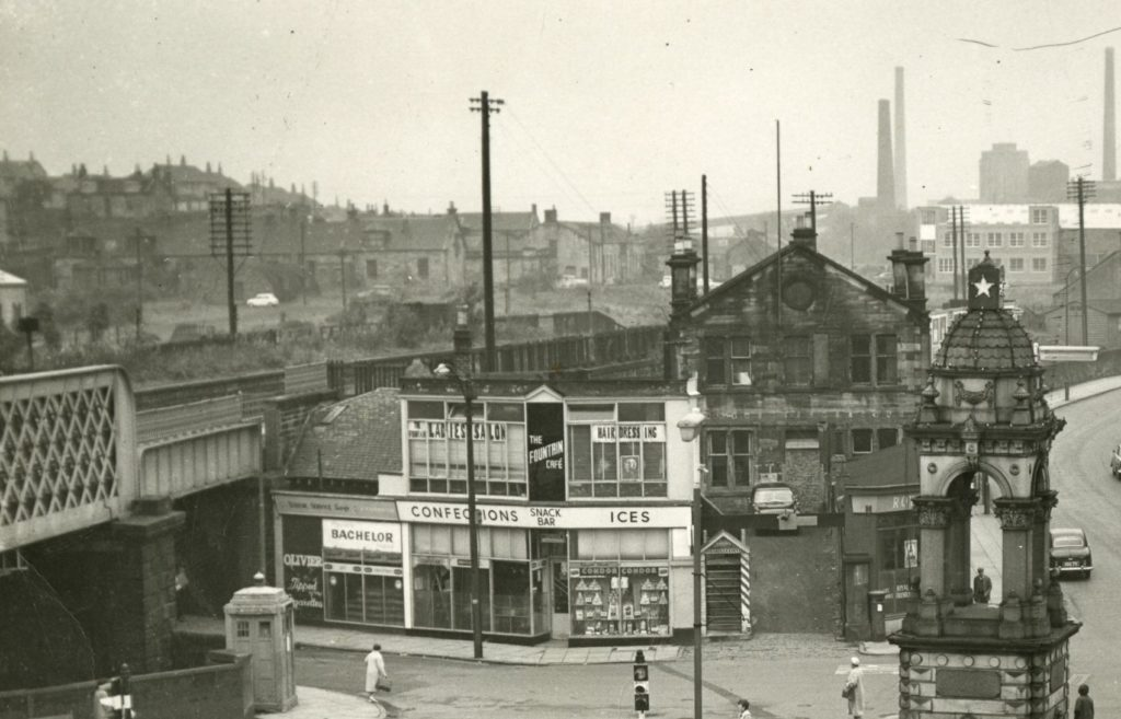 The workshops and offices of the Summerlee Iron Works can be seen in the middle distance in this photo from 1964. The chimneys in the distance on the right belong to Gartsherrie Iron Works which would close three years later.